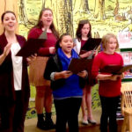 Our youth education students sing holiday carols during a Hartford Stage event at Barnes & Noble.