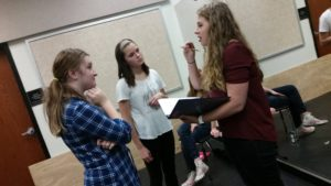 Apprentice Samantha Reser directing a scene with local students.