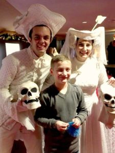 Two Christmas Ghosts pose with a fan.